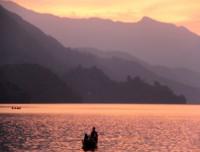 boating in phew lake in sun set