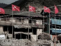 house with communist flag in rolpa guerrilla trekking
